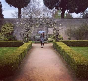 Corinn in gardens.jpg
